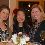 A three ladies pose for a quick photo at their high top table during the gala.