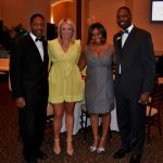 A couple poses with the hosts Jay and Barclay during the evening's events.