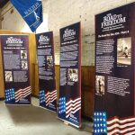 A set of four roll-up banners with information about the Road to the ADA including black and white images and information about the Disability Rights Movement.
