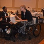 Guests took time to speak with our hosts Jay and Barclay as the evening got started including a woman in her wheelchair with her service dog beside her.