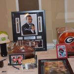 To raise funds for Walton Options, there was a Silent Auction throughout the night - these tables offer a variety of displays with the different packages that were on offer including sports memorabilia, autographs and much more.