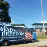 The Road to Freedom Tour Bus sits in front of Lake Olmstead Stadium before the GreenJackets game ADA25 Celebrations.