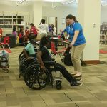 Campers tried a variety of assistive technology during camp, including wheelchairs. This group is about to have a wheelchair race!