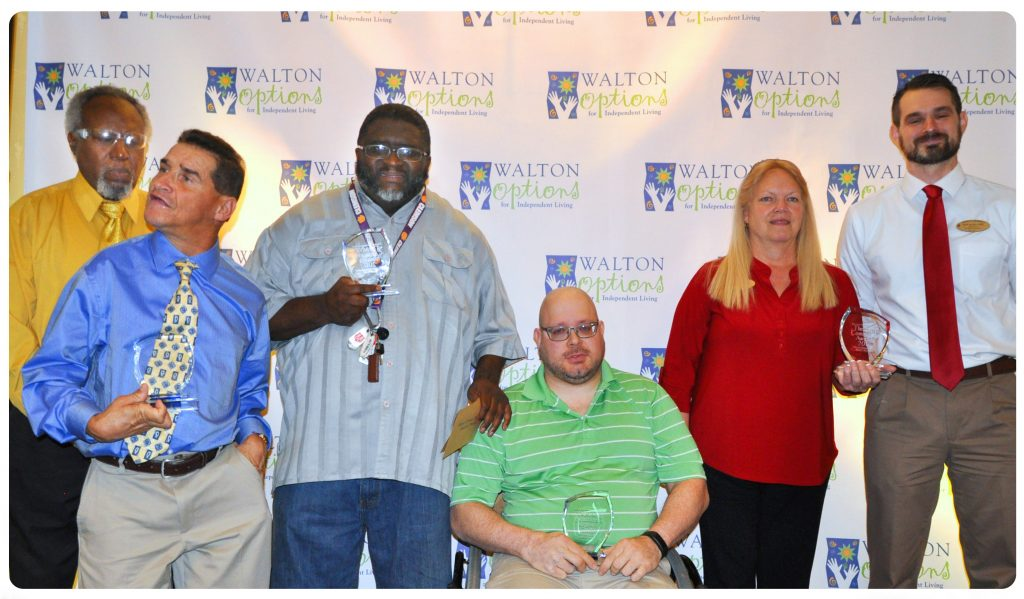 The 2017 MVP Awards Winners lined up in front of the Walton Options backdrop - from left to right: Gerald Powell, Marty Turcios, Spencer Gartrell, Robbie Breshears, Barney's Pharmacy representatives (a woman and a man)