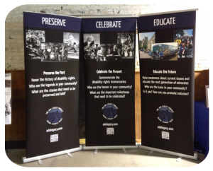 Three roll-up display banners with images and text encouraging readers to Preserve, Celebrate and Educate about the ADA Legacy