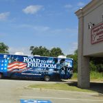 The Road to Freedom Bus is parked outside the store front of Georgia-Carolina Mobility.`