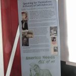 A roll-up banner with information about the History of Self-Advocacy. There is text along with images/illustrations of historical figures and places relating to Early Twentieth Century Organizing.