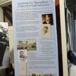 A roll-up banner with information about the History of Self-Advocacy. There is text along with images/illustrations of historical figures and places relating to Advocacy in the Nineteenth Century.