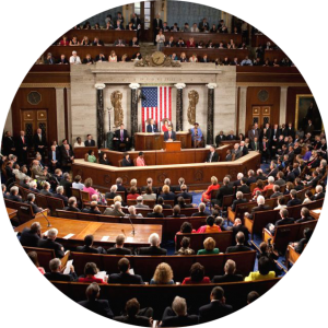 Image of US Congress in-session with a focus on the speakers podium.