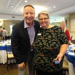 Jeff Eiseman, the MVP Community Awards Guest Speaker, poses with Walton Option's Board Chair, Lisa, at the end of the Awards Luncheon. They are both looking at the camera smiling.
