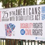 Banner with the 25th Anniversary of the ADA information on it for the CSRA Celebration during a Green Jackets Game.