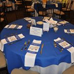 The guest tables were all set for the MVP Community Awards Luncheon with programs, and place settings.
