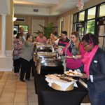 A candid photo of the lunechon line with guests preparing their food plate before the Awards Ceremony started.