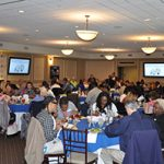 A candid photo of the MVP Community Awards Luncheon with guests sitting at their tables around the room.