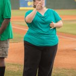 During the opening ceremony of the GreenJackets game, our ASL interpreter signs for those with hearing impairments in the crowd. She is on the baseball field along with the speakers.