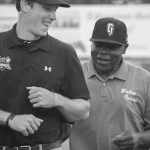 One of Walton Options' very own, Willie Jones, was honored to throw out a first pitch, recognizing the ADA's 25th anniversary. Willie is being guided back from the pitcher's mound by one of the GreenJackets' staff.