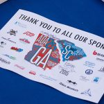 A variety of sponsors from across the CSRA helped make our ADA25 Celebrations a success. A full-color postcard sits on a table. The logo of the CSRA ADA25 celebration is in the middle with text: Thank you to all our sponsors across to the top. The sponsor logos are around the ADA25 logo.