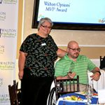 The Walton Options' Board Chair, Lisa, poses with Robbie after he received his Walton Options' MVP Award.