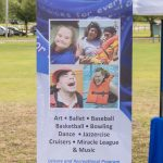 A roll-up banner for the RECing Crew with four images arranged in a square - the images are of four participants from the organization. Text below the image reads: Art, Ballet, Baseball, Basketball, Bowling, Dance, Jazzercise, Cruisers, Miracle League & Music. Leisure and Recreational Program for Individuals with Physical and Intellectual Disabilities.