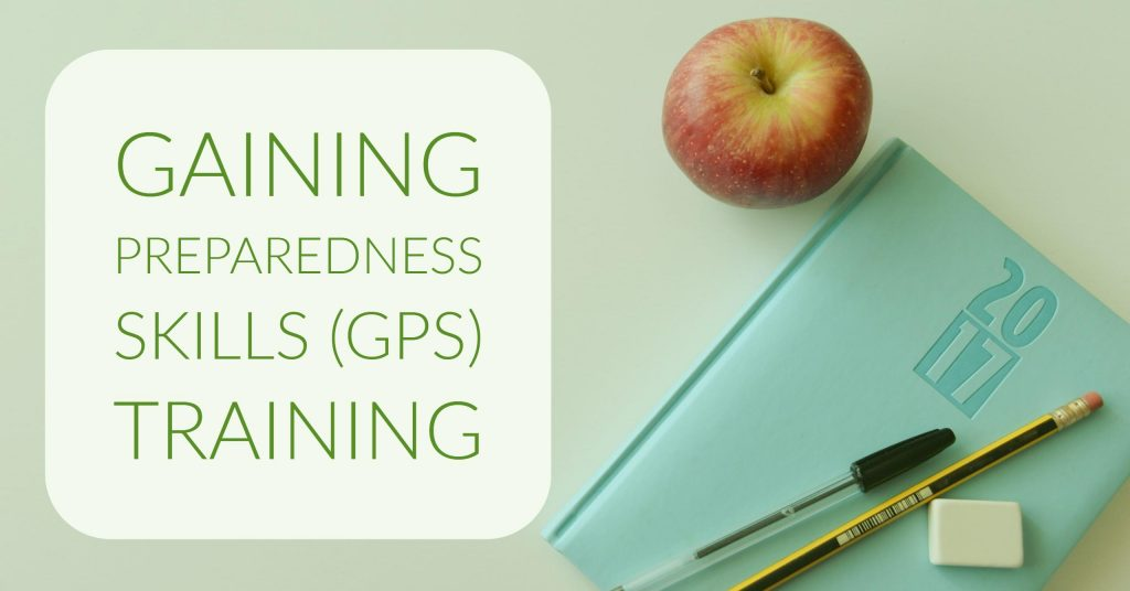 Gaining Preparedness Skills (GPS) training cover image - a white text box to the left with a planner book with a pen & pencil sitting on it to the right with the edge of an apple sitting on the table above the book.