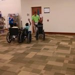 Campers tried a variety of assistive technology during camp, including wheelchairs. This group just finished their wheelchair race.