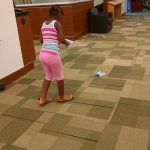 Digital technology was also highlighted this year, including robots from Tools for Life. This camper is using an iPad to drive a robot around the library.