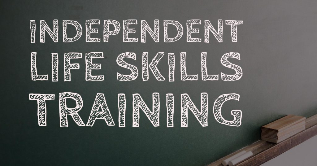 Independent Life Skills Training text on a blackboard background