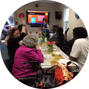 A group class at the North Augusta Office with consumers looking at the screen at the end of the their table