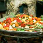 One of the food displays from Pigskins & Bowties - a close up of the bowl with cheese, tomatoes and herbs.