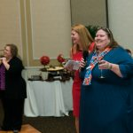 During the Gala, Walton Options celebrated 20 years of service with a speech from Chair of the Board Beth Morrison and a special recognition for executive director Tiffany Clifford - seen here ready to toast Walton Options' anniversary.
