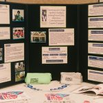 A table top display with information about all of Walton Options' different services and programs including photos. There is also t-shirts and memory books from the ADA25 celebrations.