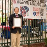 Prior to the first pitch, Commissioner Sean Frampton posted with our City of Augusta Proclamation honoring the ADA's 25th anniversary. He is standing next to our banner honoring the anniversary as well.