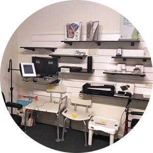 Photo: a series of shelves and tables displaying various assistive technology devices at the STAR Program Hub at the Augusta Office.