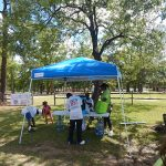 Members of the community gather around one of the water stations during our ADA25 Celebration event.