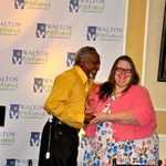 Walton Options' Executive Director Tiffany presents the MVP Awards for Outstanding Individual Advocate to Gerald.